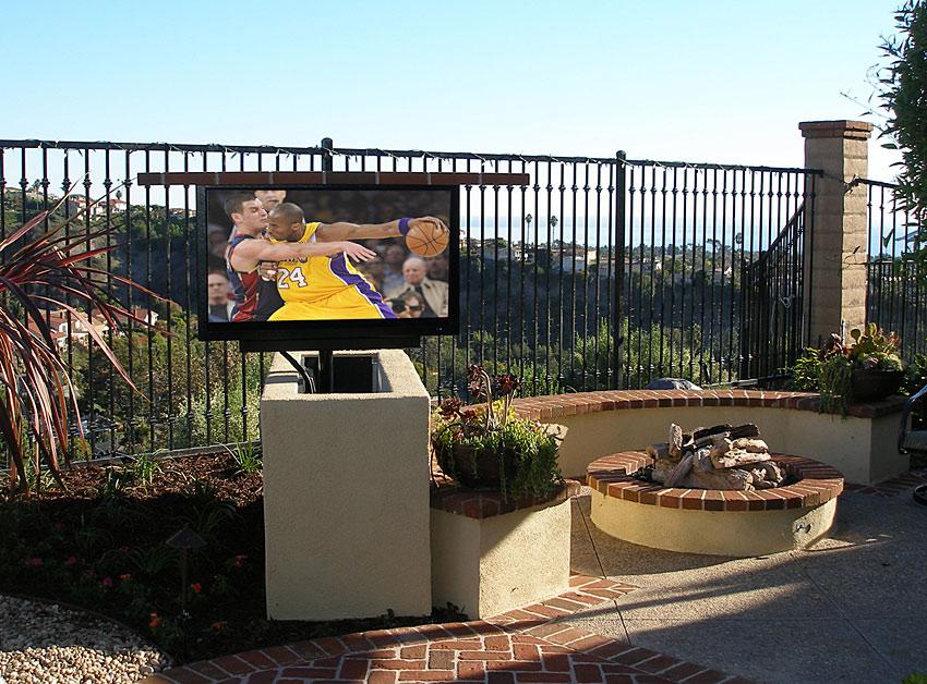 Sunbrite Outdoor TV in custom stucco TV lift with swivel