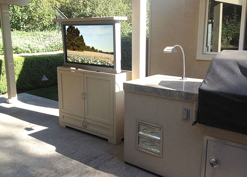 Wood outdoor TV lift, raised view.  Sunbrite TV.