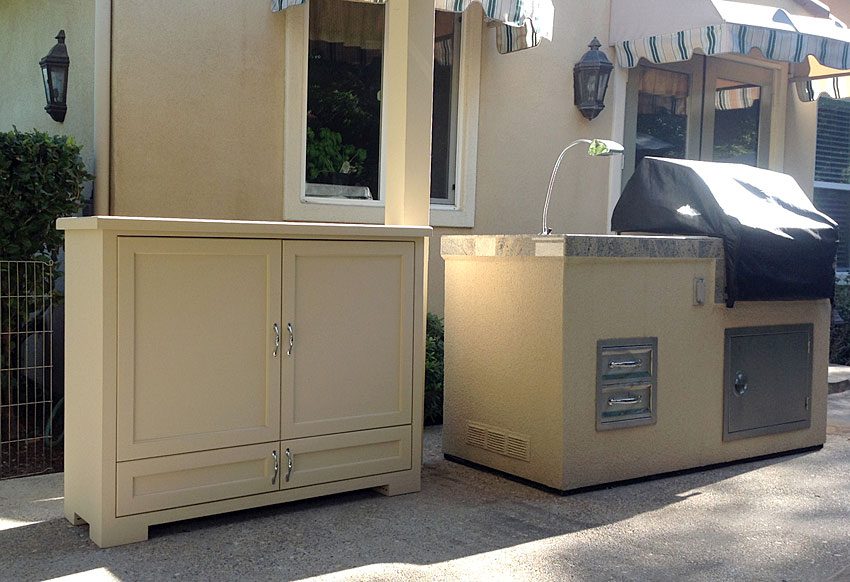 Outdoor wood TV lift to compliment BBQ details