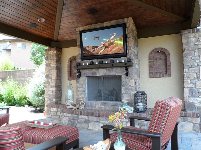 Outdoor TV in patio cover, sunbrite, mounted to stone