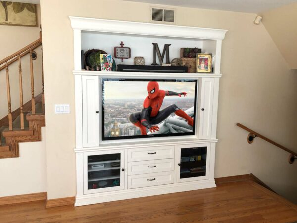 Custom White Built-In Wall Unit organized a complete home theater system
