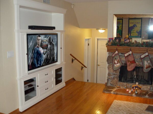 Side view of white mobile built-in entertainment center.