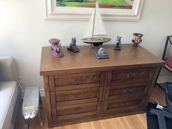 Decorated view of six drawer Mission style oak media cabinet