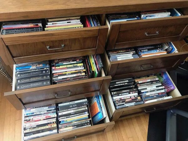 Open view of DVD storage drawers, houses box sets, and other sizes of media.