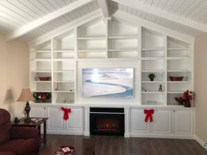 White Built-In Wall Unit with Cathedral Ceilings and Electric Fireplace