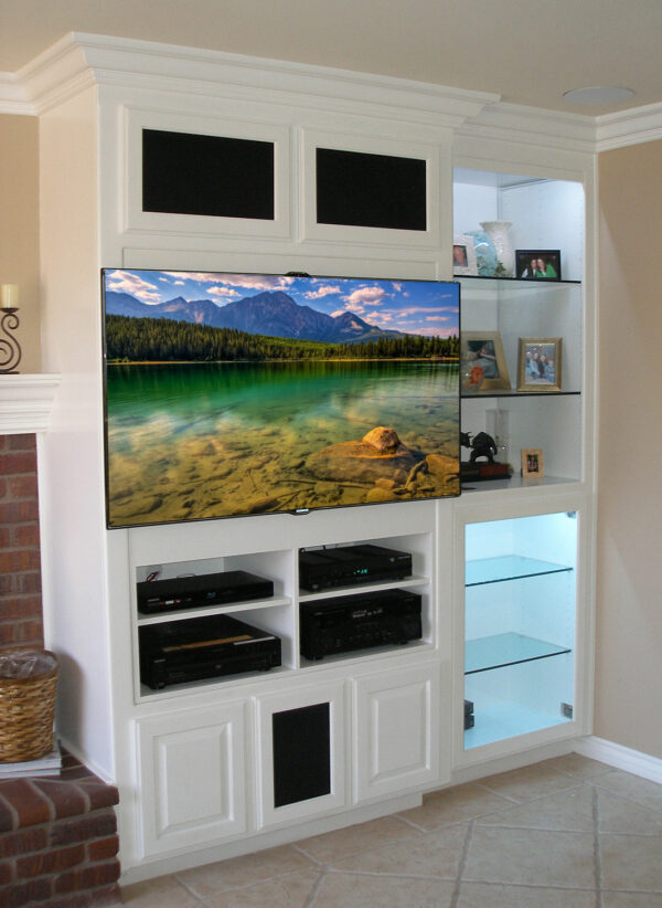 The flat panel TV rested just on top of the face frame of the furniture.