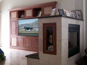 Traditional built-in wall unit, fireplace cabinet, and refrigerator cabinet.