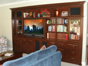 Built-in Entertainment Wall Unit in Cherry Finish with Bookcases and Lighted Display Space