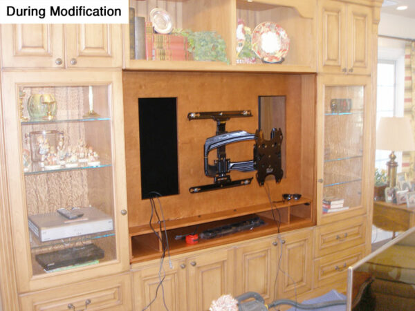 Here you can see the structural back wall, custom sound bar riser, and pull-out articulating wall bracket.