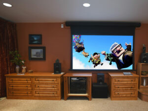 Matching media cabinets under motorized movie screen