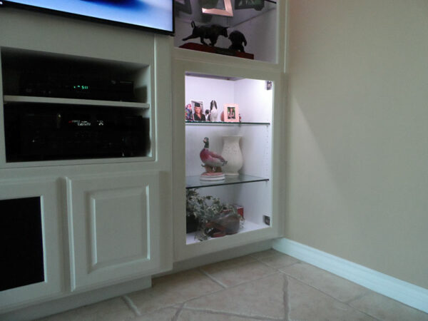 The old electronics sectuion was modified with glass shelves and LED lights.