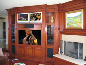 Floor to ceiling built-in home theater wall unit