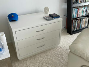 Three drawer white CD storage cabinet