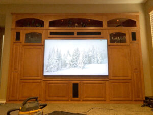 Large built-in home theater unit upgraded for big flat panel TV.