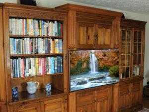 Custom furniture retrofit for pine wall unit.