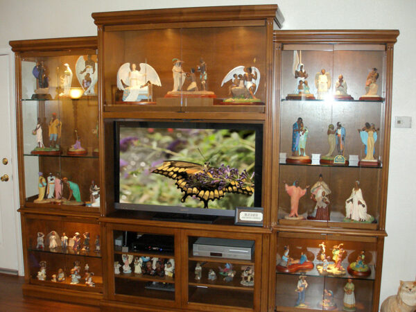Three piece custom entertainment center and display cabinets.
