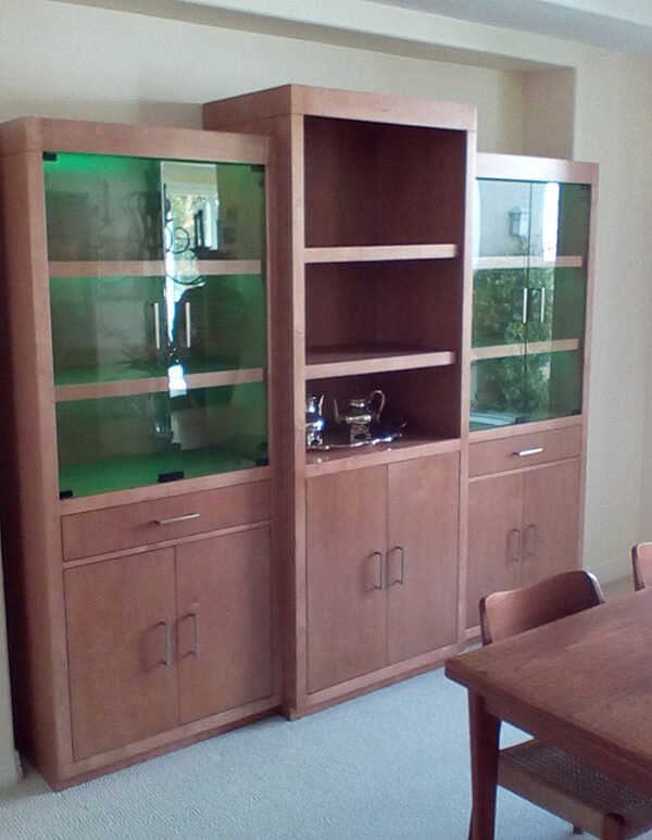 Here we can see green LED lights behind the frameless clear glass swith doors of the CWU-4 wall unit.