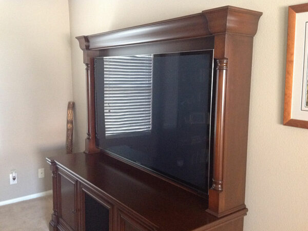 Angled view of the cabinet top shows the decorative columns