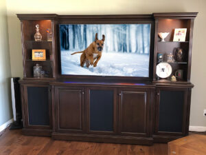Traditional custom wall unit shown in an Espresso finish with lighted display space